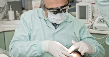 dentist tending to a patient