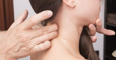 woman getting help with neck pain