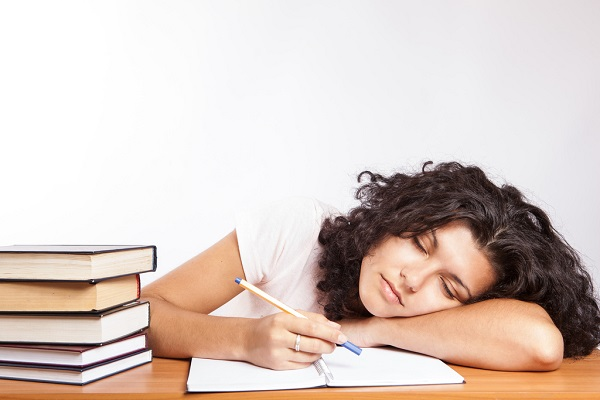 girl sleeping with head on desk